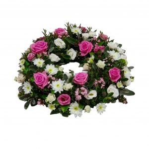 Pink and White Wreath - A Luxurious design of Pink and White Flowers including Pink Roses, Pink Lisianthus and a selection of Fresh Green Foliage.