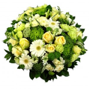 Shamrock Serenity Funeral Posy - A Luxurious selection of Cream Roses & White Gerberasarranged with contrasting Green Shamrock Blooms and touched with Sweeping Bear Grass.