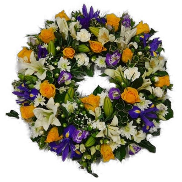 Sweet Haven Funeral Wreath - A Beautiful selection of Seasonal Flowers including Roses, Lillies, Chrysanthemums & Iris and a selection of Fresh Green Foliage.