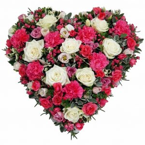 Love Heart Funeral Tribute - A Loose, Heart Shaped, Funeral Tribute filled with Roses, Carnations and Lisianthus in a colour of your choice.