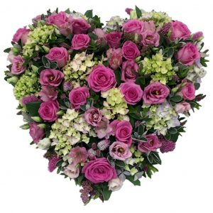 Hydrangea Heart Funeral Tribute - A Loose, Heart Shaped, Funeral Tribute filled with Roses, Hydrangea and Lisianthus in a colour of your choice.
