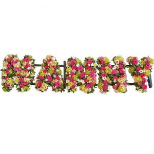 Nanny Funeral Tribute – A loose design Nanny Name Tribute with Beautiful Cerise Roses, Hydrangea & Lisianthus.