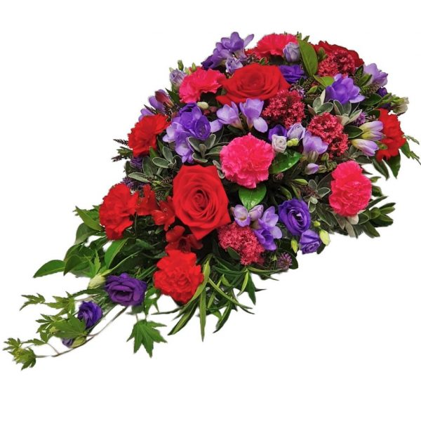 Woodland Single Ended Spray -A Beautiful Design of Rich Vibrant Roses & Lisianthuswith a selection of Fresh Foliage arranged in a Tasteful Funeral Spray.