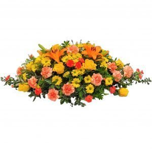 St Clements Funeral Spray - A Beautiful selection of Yellow Roses arranged with Orange Lilies, Carnations & Chrysanthemum.